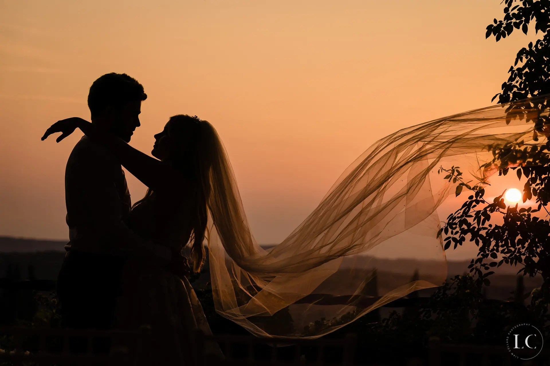Shadows of bride and groom embracing