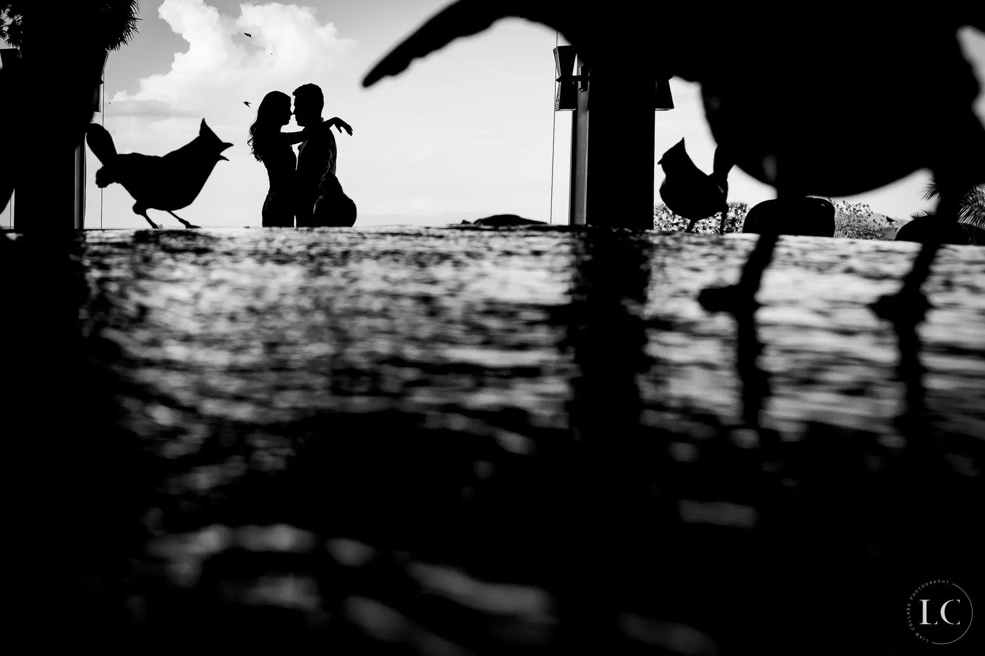 Bride and groom embracing shadows