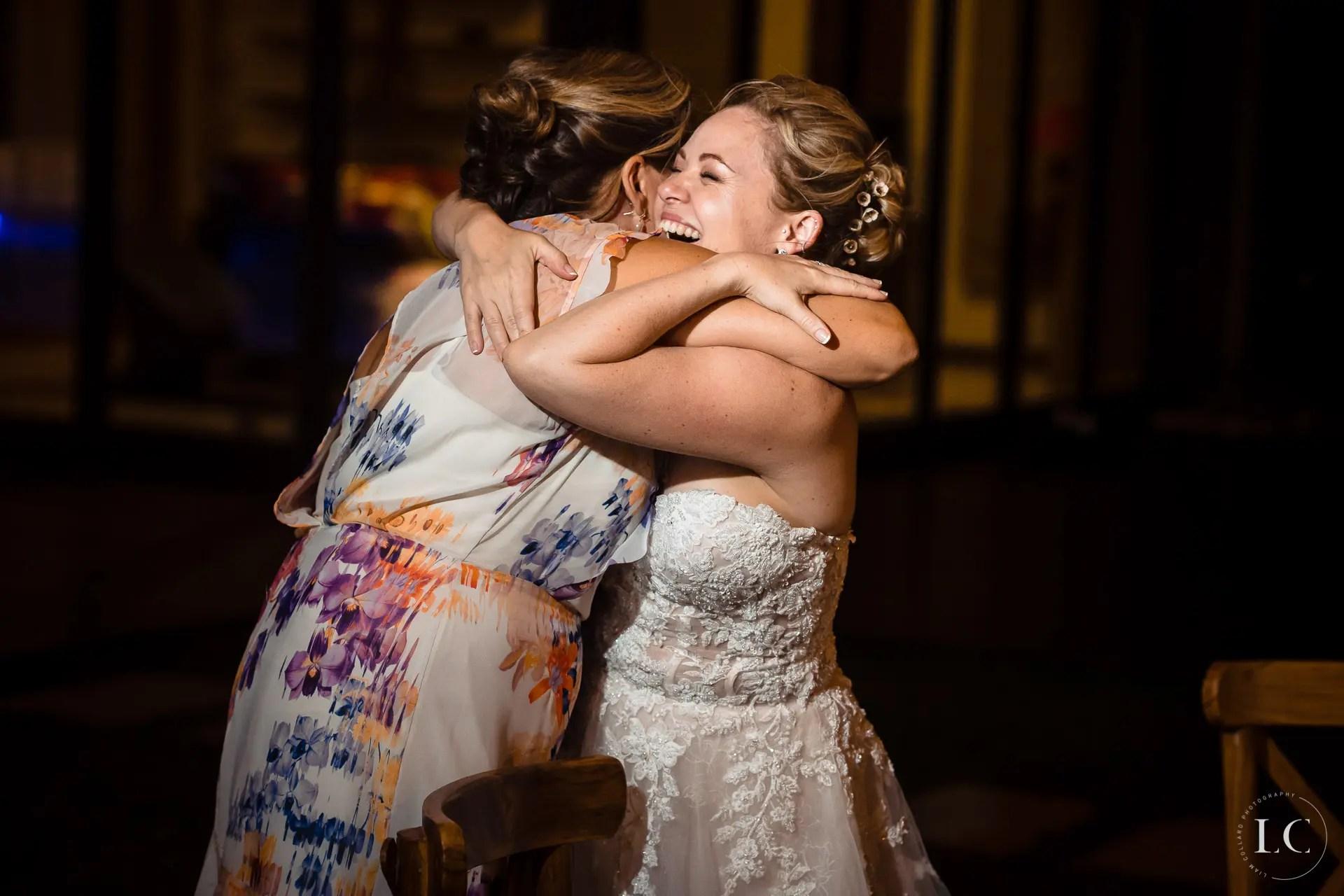 Bride hugging a guest