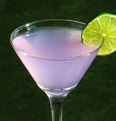 Chronic Tonic (2 Oz. Hpnotiq Harmonie 1.5 Oz. Gin 2.5 Oz. Tonic Water Lime Wheel For Garnish)