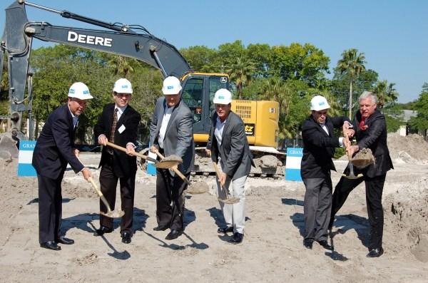 The mayor, developer, and CEO Bob Glaser of Smith & Associates shovel a bit of dirt!