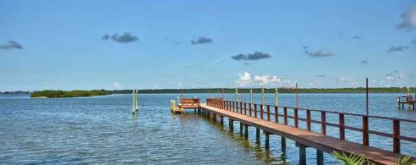 Just Reduced Over $100K:  1 acre lot on Boca Ciega Bay to Build Your Dream Home