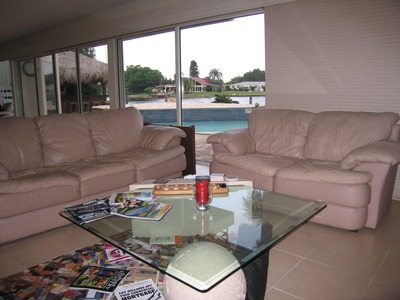 Lovely living room with a view of the pool, and a lot of crap sitting on our coffee table!