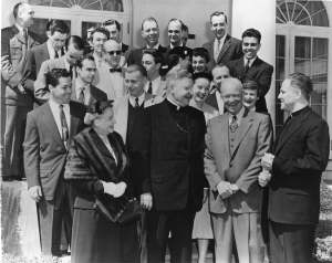Father Gilbert Hartke with President Eisenhower and students in 1955