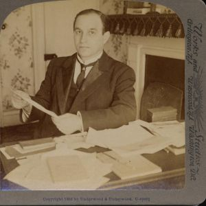 UMWA President John Mitchell working at his desk, 1906. John Mitchell Papers, American Catholic History Research Center and University Archives.