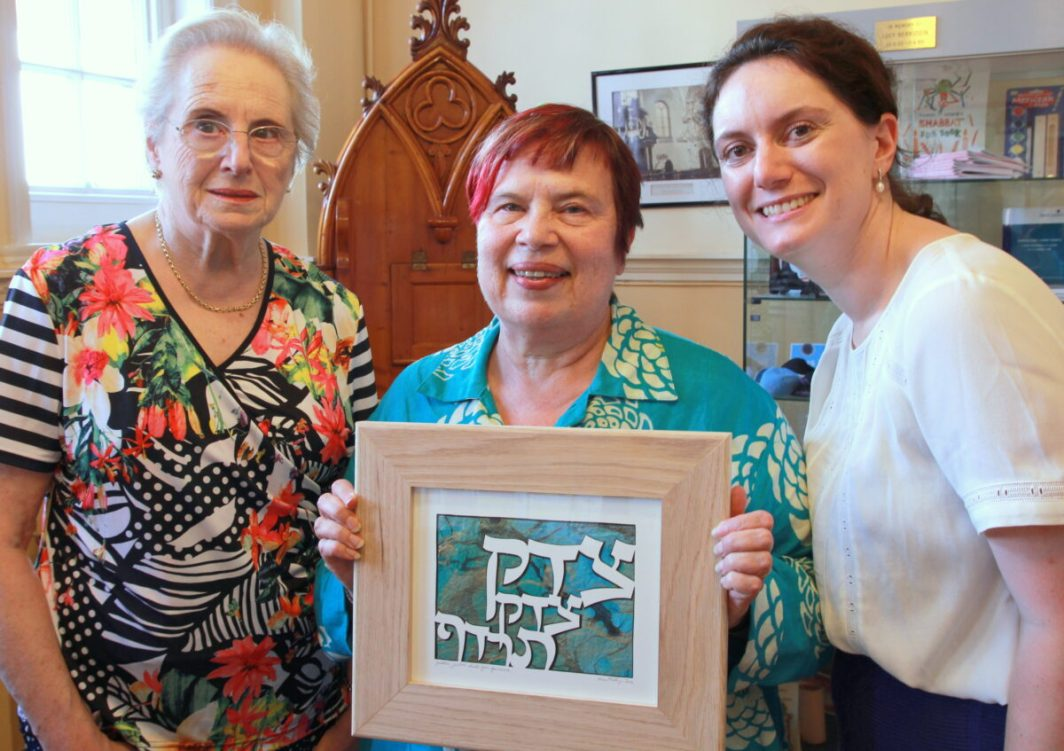 Louise Freedman and Alice Alphandary present Rabbi Janet Darley (centre) with a leaving gift