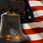 Liberty Bell with us flag behind image