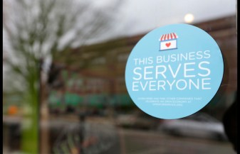 A window sticker on a downtown Indianapolis business, Wednesday, March 25, 2015, shows its objection to the Religious Freedom bill passed by the Indiana legislature. Organizers of a major gamers' convention and a large church gathering say they're considering moving events from Indianapolis over a bill that critics say could legalize discrimination against gays. (AP Photo/Michael Conroy)