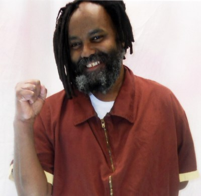 https://i1.wp.com/www.liberationnews.org/wp-content/uploads/2015/03/Mumia_raised_fist_020612_web.jpg?resize=400%2C389&ssl=1