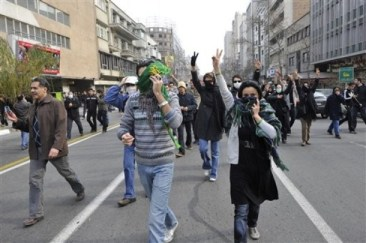 This photo, taken by an individual not employed by the Associated Press and obtained by the AP outside Iran shows Iranian protestors flashing the victory sign, as they cover their faces to avoid to be identified by security during anti-government protest in Tehran, Iran, Sunday, Dec. 27, 2009. (AP Photo) EDITORS NOTE AS A RESULT OF AN OFFICIAL IRANIAN GOVERNMENT BAN ON FOREIGN MEDIA COVERING SOME EVENTS IN IRAN, THE AP WAS PREVENTED FROM INDEPENDENT ACCESS TO THIS EVENT