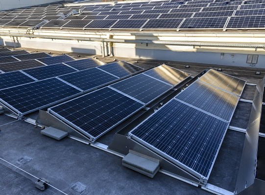 Solar panels on the roof of a building in detail.