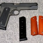 Preowned Armscor Rock Island, .45 ACP, 5″ Barrel, Steel Frame, Parkerized Finish, Wood & Rubber Grips, 2 Magazines, 8 Rounds: $439