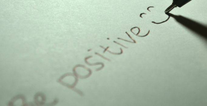 Pen writing words be positive