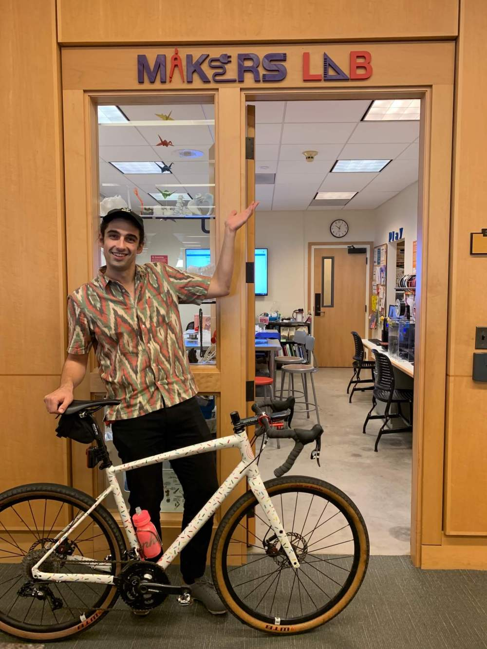 Angelo with bike outside of Makers Lab