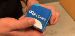 Multicolored tricube puzzle featuring information about Education Research Services provided by UCSF Education Reference librarians.