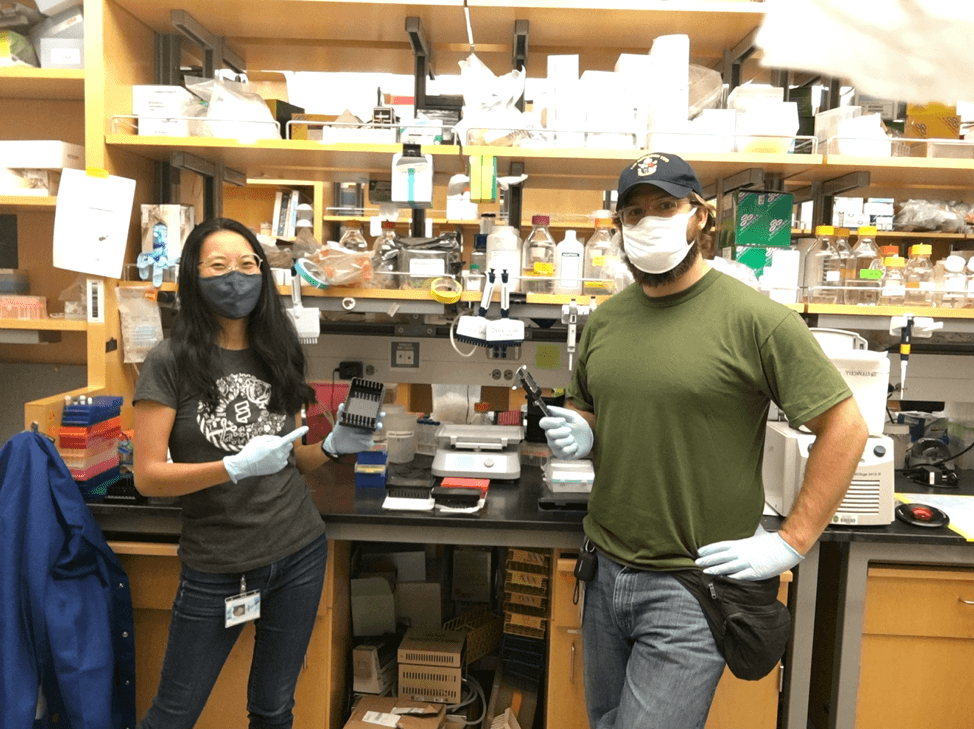Gavin and lab mate in research lab