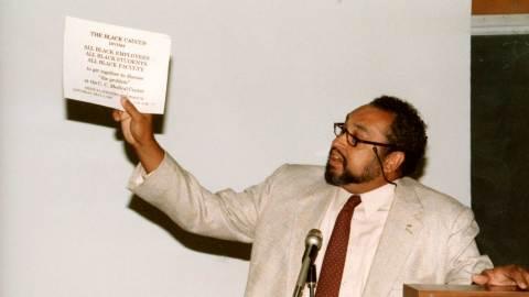 bradley holding black caucus sign