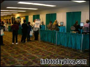 Attendees wait to use the Internet Cafe