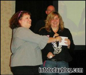 Janie Hermann presents the First Place prize to Amy Buckland