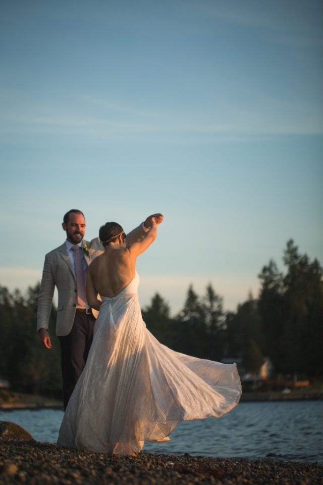 Tacoma Bride and groom dance together on beach at sunset