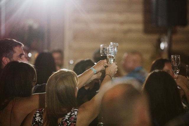 Washington wedding guests raise champagne glasses after a toast.