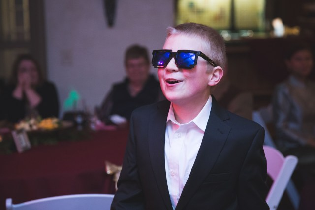 Bride's son during reception wearing sunglasses from minecraft
