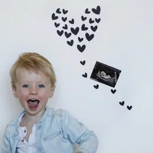 hartjes en echo foto zwangerschapsaankondiging