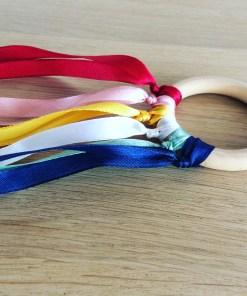 Handvlieger regenboog pastel, handslinger regenboog, regenboogkindje, regenboog speelgoed, liefsvanlauren.nl