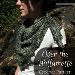 Over the Willamette is a triangular scarf with mesh sections separated by lacy bands. With this crochet pattern you can make a scarf or a full-sized shawl.