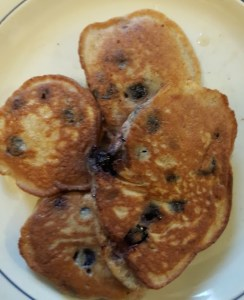 A plate of freshly made low-carb blueberry pancake, ready to eat.