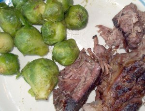 Brussels sprouts with roast beef on a plate