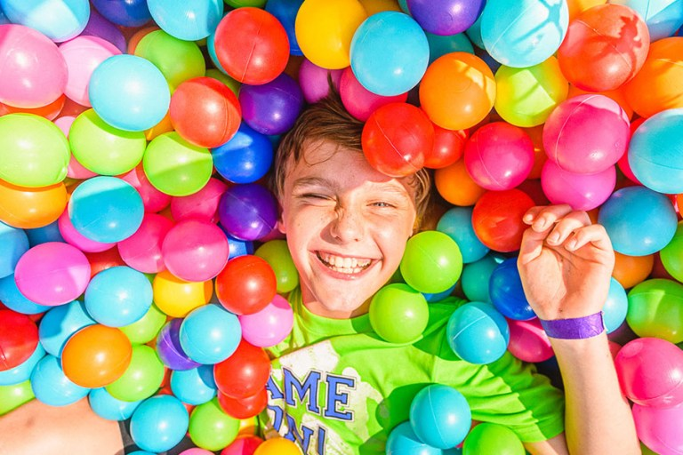 A kid in the ball pit