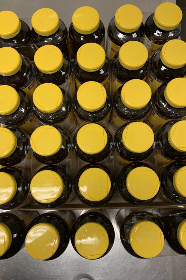 Stack of yellow topped fish oil supplement bottles.