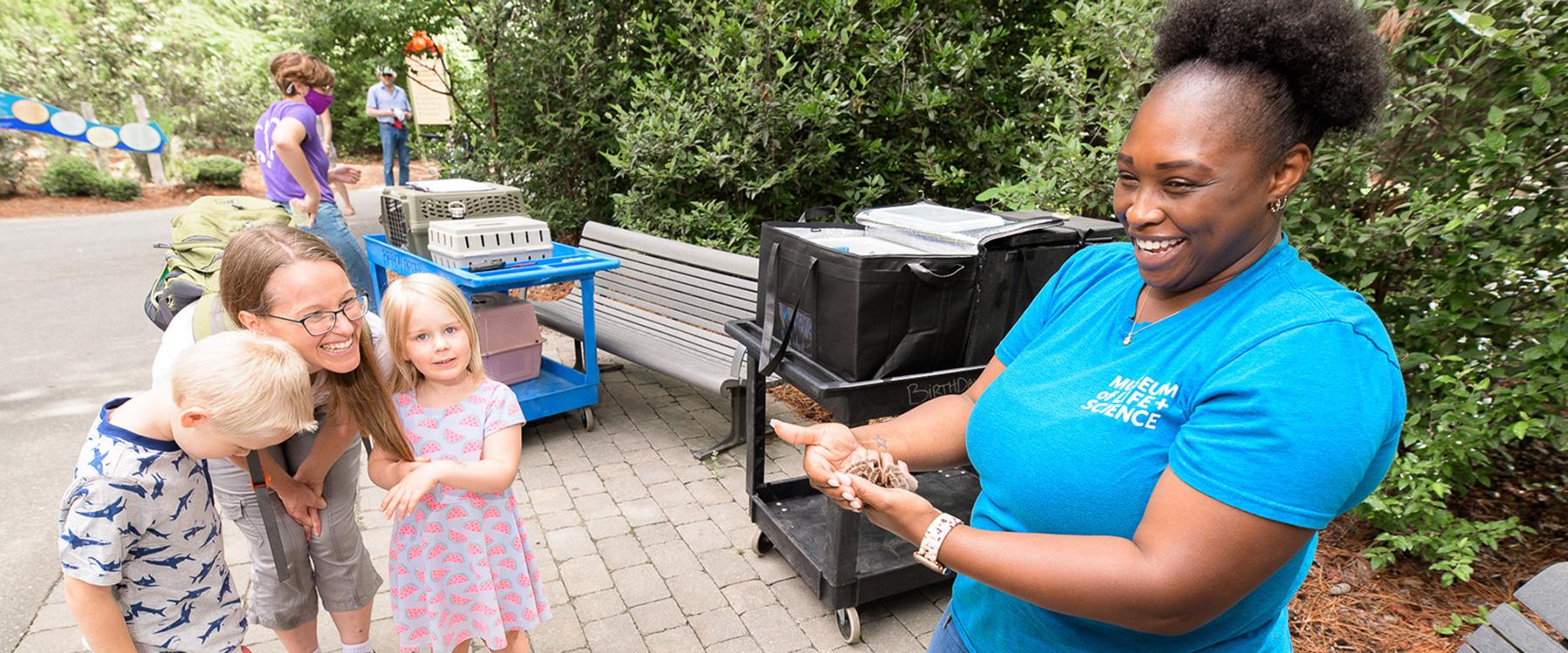 An educator showing a tarantula to guests