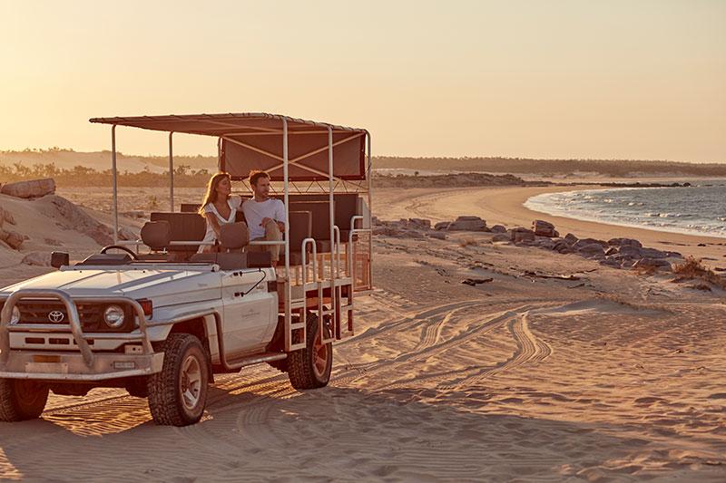 4WD on beach sunset
