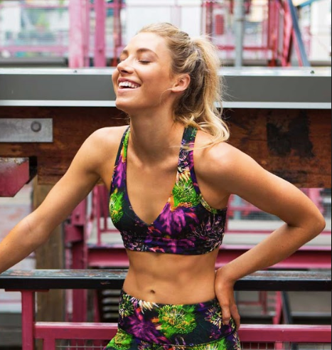 Woman smiling in exercise clothing