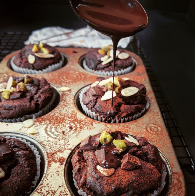 Pouring chocolate onto quinoa muffins