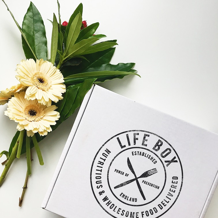 a vegan snacks Lifebox and flowers