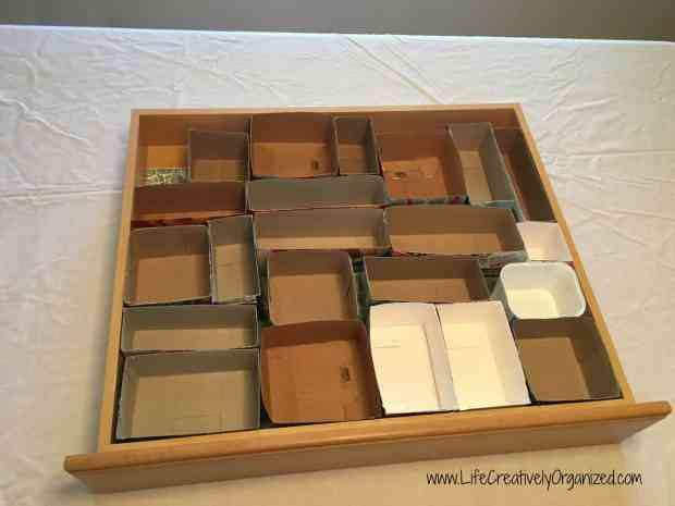 Organize your junk drawer with recycled boxes! An easy way to re-organize a junk drawer without spending any extra money and do some recycling, to boot!