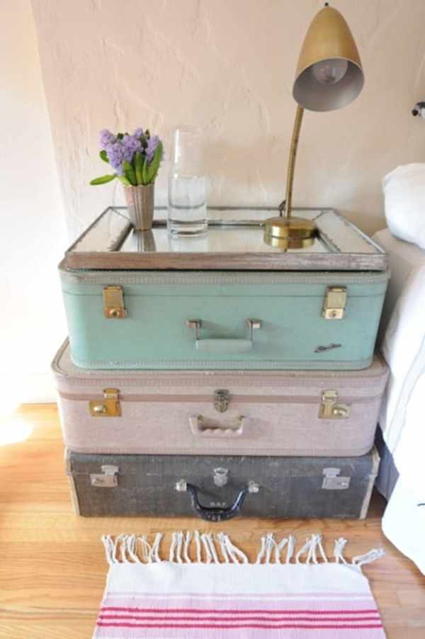 Here are some beautiful ways to add more storage in your home using re-purposed items, like a stack of vintage suitcases.