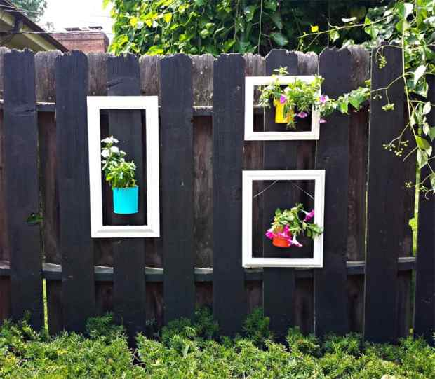 Outdoor decorating - dress up a fence with frames and cans