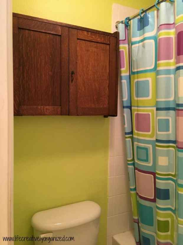 Kids' bathroom makeover - adding a storage cabinet over the toilet.