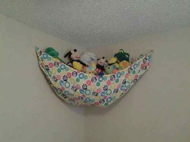 Crib sheet hammock for toy storage