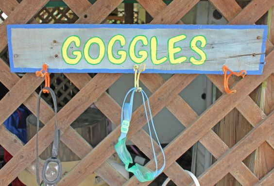 Awesome pool storage ideas - google holder from weathered wood and hooks