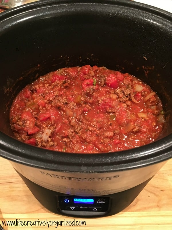 Crock pot goulash with spinach. Easy, cheesy, beefy goodness. What's not to love?! This goulash is made right in a slow cooker. And, it's ridiculously easy!