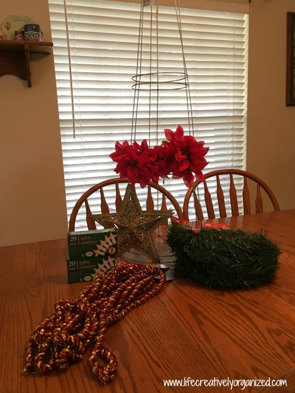 Here is how I made a lit Christmas tomato cage topiary that's every bit as gorgeous as store-bought ones, and I spent just $26 making 2 of them.