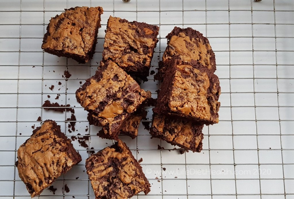 Biscoff brownie squares on a wire baking rack