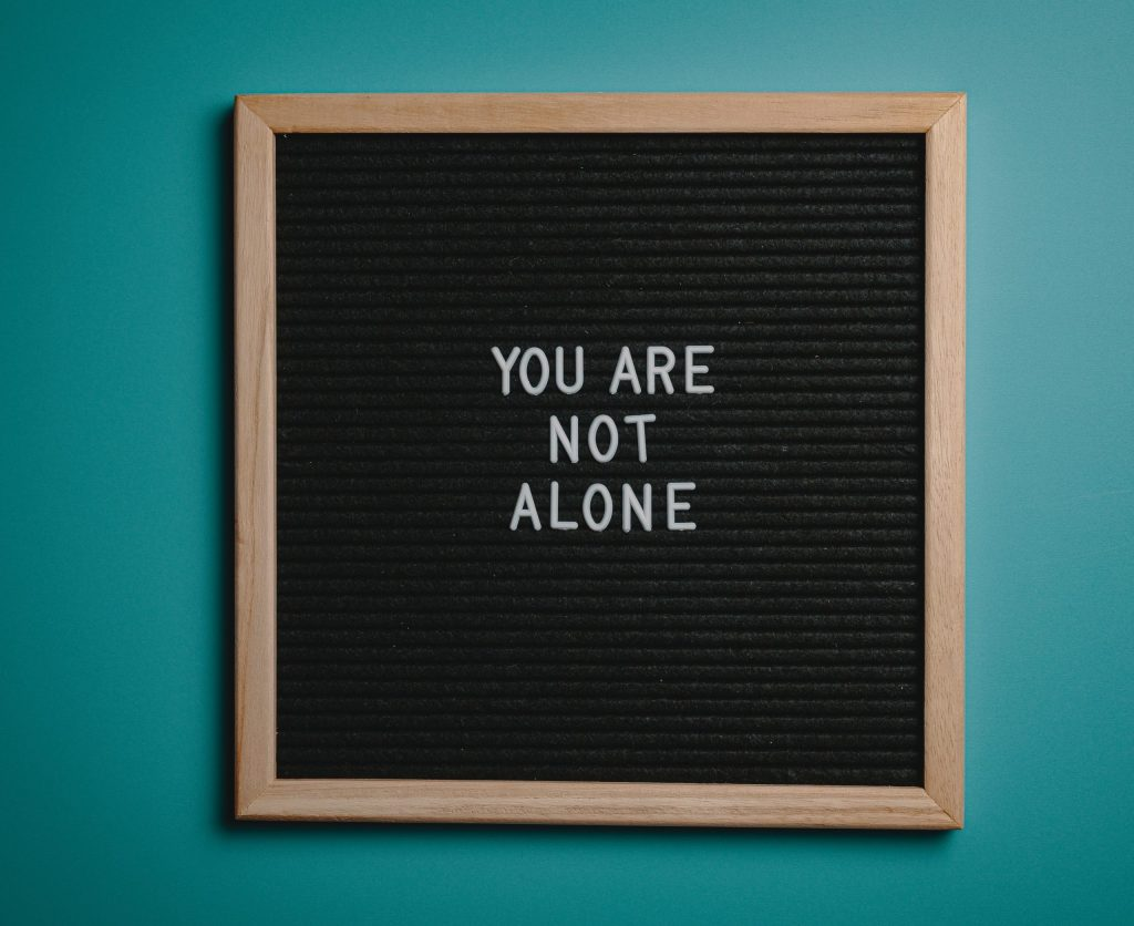 Board with the words you are not alone.