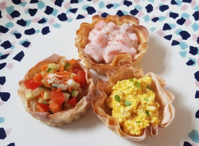 Three vol au vents on a plate with various vegan fillings