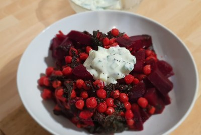 Bowl of beetroot curry with raita